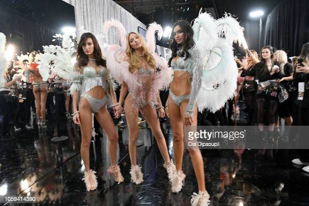 Bella Hadid Martha Hunt and Kelly Gale pose backstage during the 2018 Victoria's Secret Fashion Show at Pier 94 on November 8 2018 in New York City