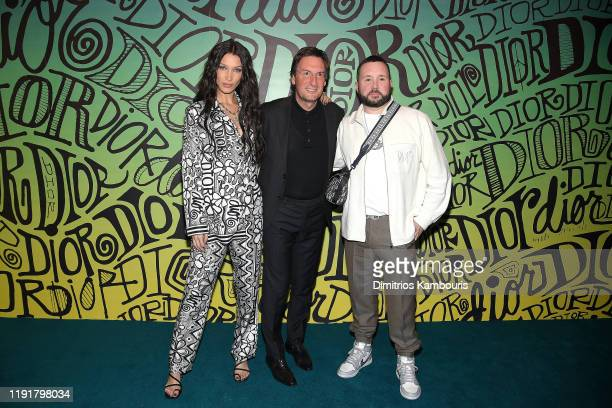 Bella Hadid Pietro Beccari and Kim Jones attend the Dior Men's Fall 2020 Runway After Party on December 03 2019 in Miami Florida