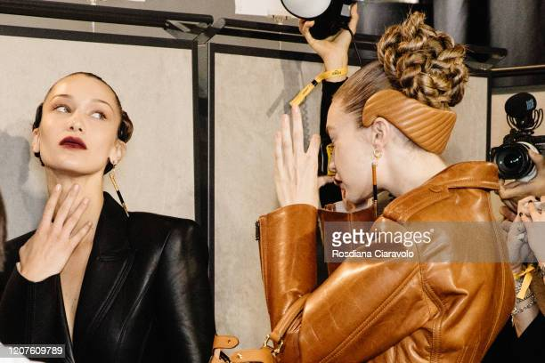 Bella Hadid pose for Gigi Hadid singleuse camera during backstage at the Fendi fashion show on February 20 2020 in Milan Italy