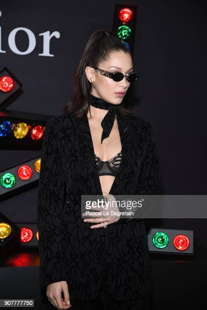 Bella Hadid poses at Dior Homme Menswear Fall/Winter 20182019 show as part of Paris Fashion Week at Grand Palais on January 20 2018 in Paris France