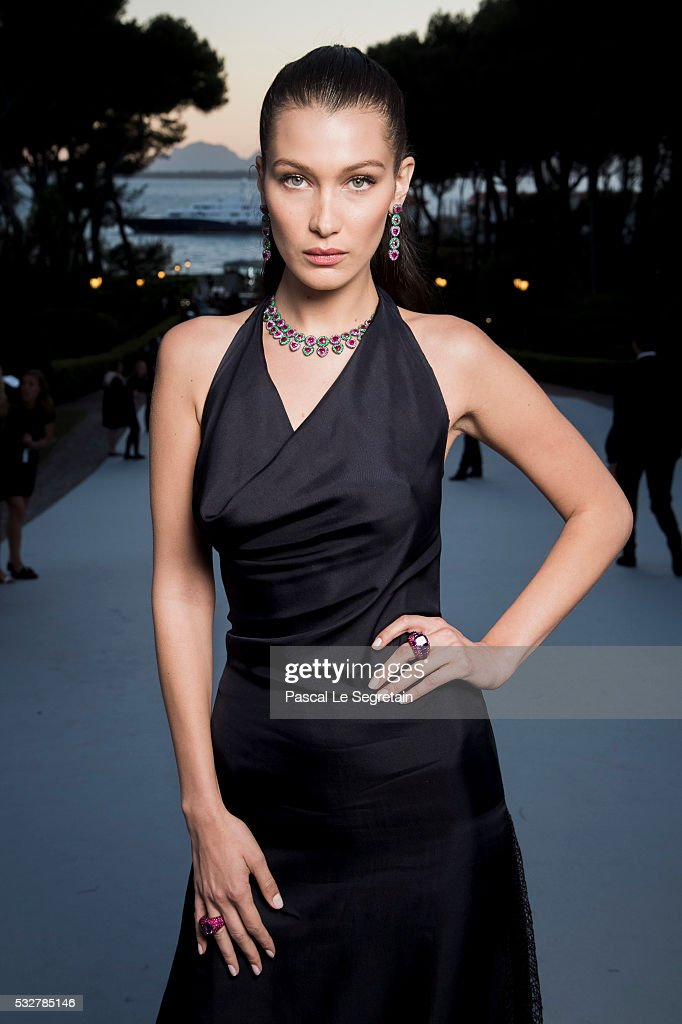 Bella Hadid poses for photographs at the amfAR's 23rd Cinema Against AIDS Gala at Hotel du Cap-Eden-Roc on May 19, 2016 in Cap d'Antibes, France.