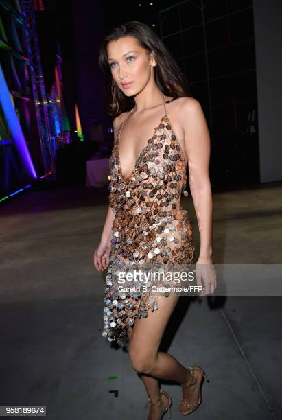 Bella Hadid prepares backstage at Fashion for Relief Cannes 2018 during the 71st annual Cannes Film Festival at Aeroport Cannes Mandelieu on May 13,...