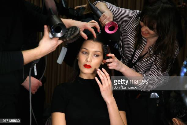 Bella Hadid prepares backstage during the Brandon Maxwell show during February 2018 New York Fashion Week at Appel Room on February 11 2018 in New...