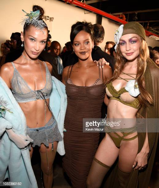 Bella Hadid Rihanna and Gigi Hadid pose backstage for the Savage X Fenty Fall/Winter 2018 fashion show during NYFW at the Brooklyn Navy Yard on...