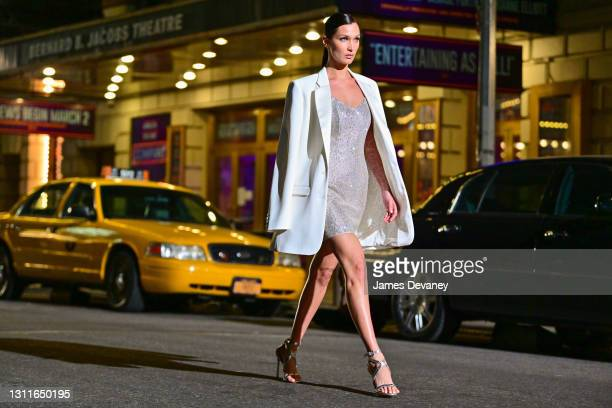 Bella Hadid walks along 46th Street during the Michael Kors Fashion Show in Times Square on April 08, 2021 in New York City.