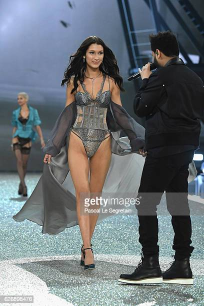 Bella Hadid walks during the runway at the Victoria's Secret Fashion Show on November 30 2016 in Paris France