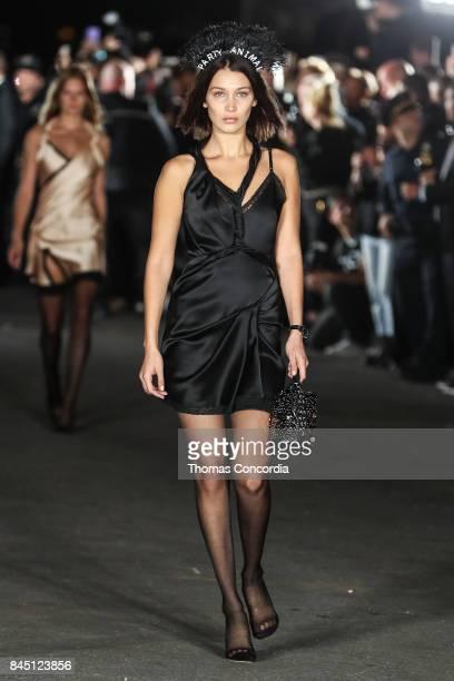 Bella Hadid walks the alleyway wearing Alexander Wang during Wangfest on September 9, 2017 in New York City.