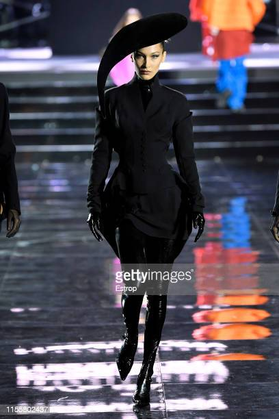 Bella Hadid walks the CR Runway x LuisaViaRoma at Piazzale Michelangelo during the Pitti Immagine Uomo 96 on June 13 2019 in Florence Italy