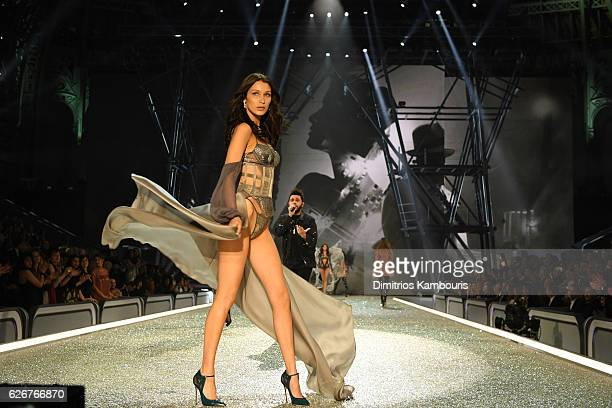 Bella Hadid walks the runway as The Weeknd perfoms during the 2016 Victoria's Secret Fashion Show on November 30 2016 in Paris France