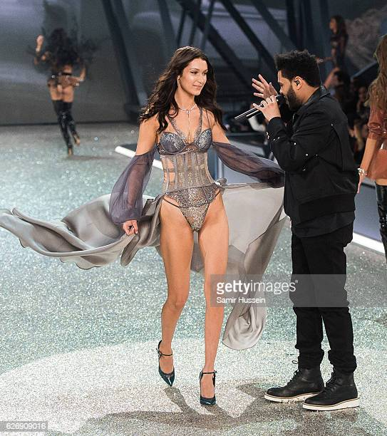 Bella Hadid walks the runway as The Weeknd performs during the annual Victoria's Secret fashion show at Grand Palais on November 30 2016 in Paris...