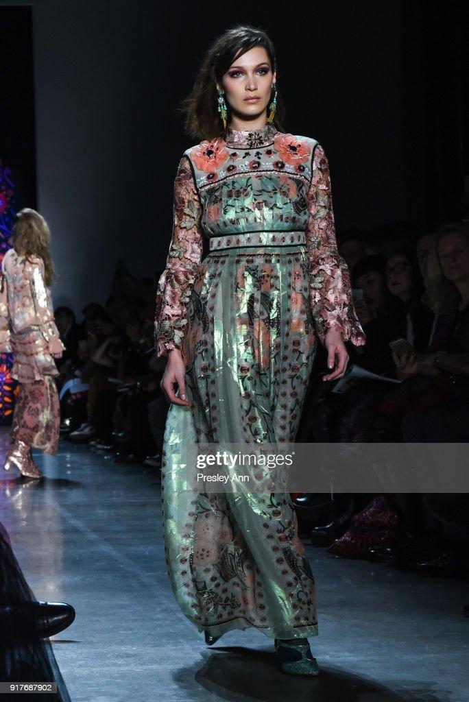 Bella Hadid walks the runway at Anna Sui - Runway - February 2018 - New York Fashion Week: at Spring Studios on February 12, 2018 in New York City.