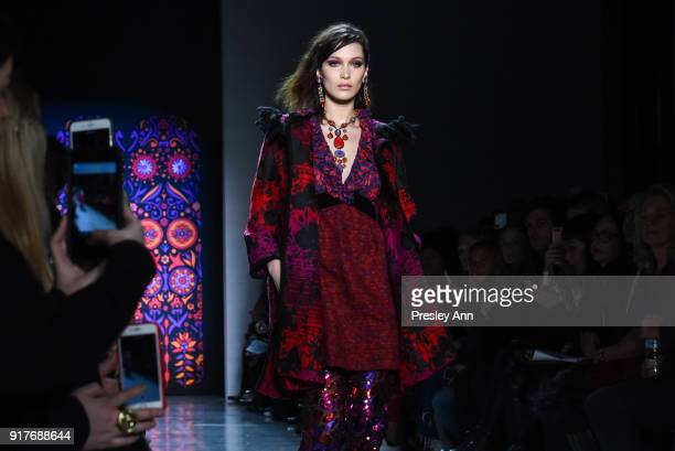 Bella Hadid walks the runway at Anna Sui Runway February 2018 New York Fashion Week at Spring Studios on February 12 2018 in New York City