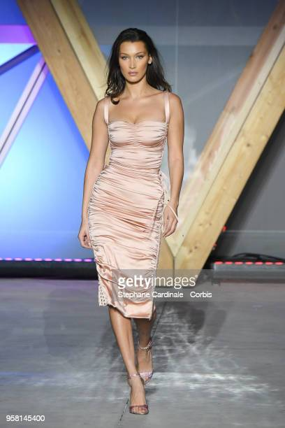 Bella Hadid walks the runway at Fashion For Relief Cannes 2018 during the 71st annual Cannes Film Festival at Aeroport Cannes Mandelieu on May 13...