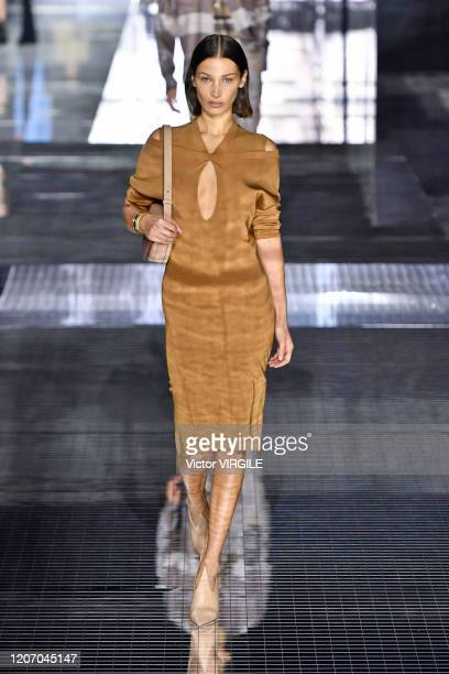 Bella Hadid walks the runway at the Burberry Ready to Wear Fall/Winter 2020-2021 fashion show during London Fashion Week on February 17, 2020 in...