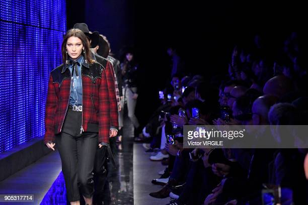 Bella Hadid walks the runway at the Dsquared2 show during Milan Men's Fashion Week Fall/Winter 2018/19 on January 14 2018 in Milan Italy