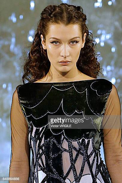 Bella Hadid walks the runway at the Fendi Roma 90 Years Anniversary fashion show at the Fontana di Trevi on July 7 2016 in Rome Italy