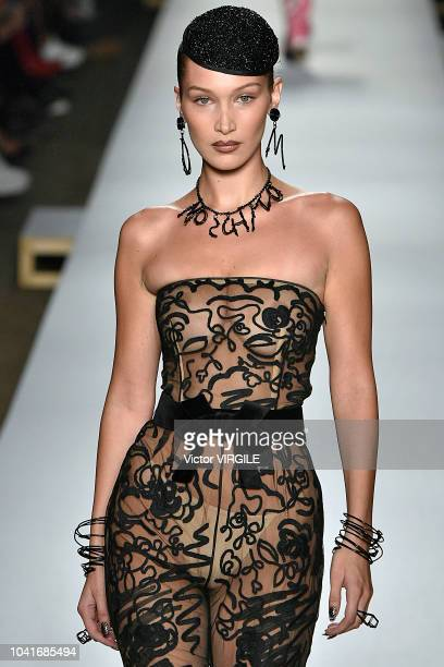 Bella Hadid walks the runway at the Moschino Ready to Wear fashion show during Milan Fashion Week Spring/Summer 2019 on September 20 2018 in Milan...