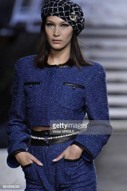 Bella Hadid walks the runway during Chanel Cruise 2018/2019 Collection fashion show at Le Grand Palais on May 3 2018 in Paris France