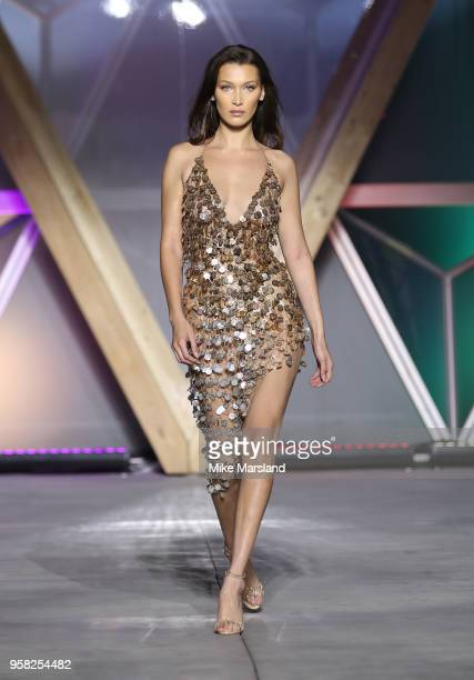 Bella Hadid walks the runway during Fashion For Relief Cannes 2018 during the 71st annual Cannes Film Festival at Aeroport Cannes Mandelieu on May 13...