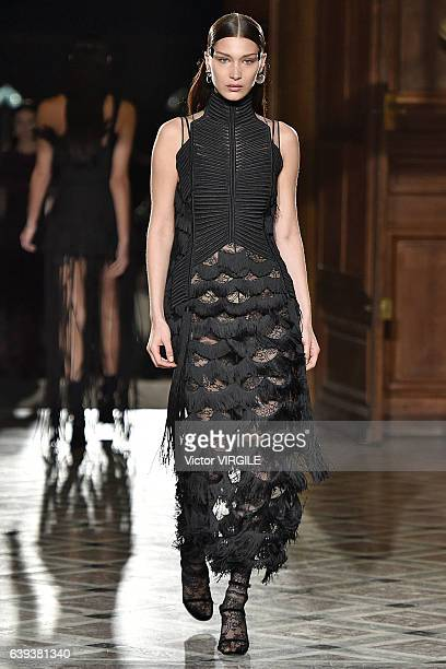 Bella Hadid walks the runway during the Givenchy Menswear Fall/Winter 20172018 show as part of Paris Fashion Week on January 20 2017 in Paris France