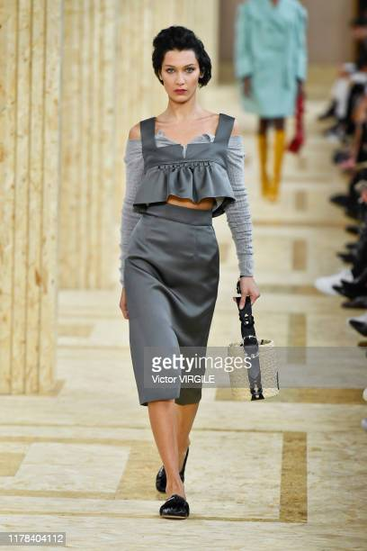 Bella Hadid walks the runway during the Miu Miu Ready to Wear Spring/Summer 2020 fashion show as part of Paris Fashion Week on October 01, 2019 in...
