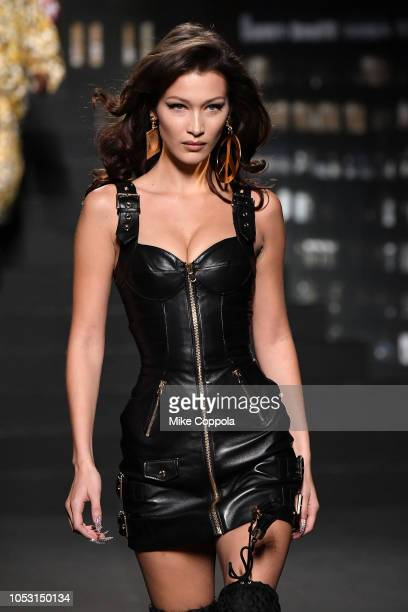 Bella Hadid walks the runway during the Moschino x HM Runway at Pier 36 on October 24 2018 in New York City