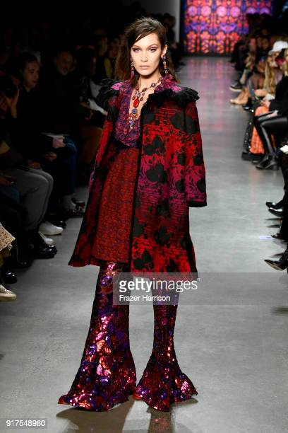 Bella Hadid walks the runway for Anna Sui during New York Fashion Week The Shows at Gallery I at Spring Studios on February 12 2018 in New York City