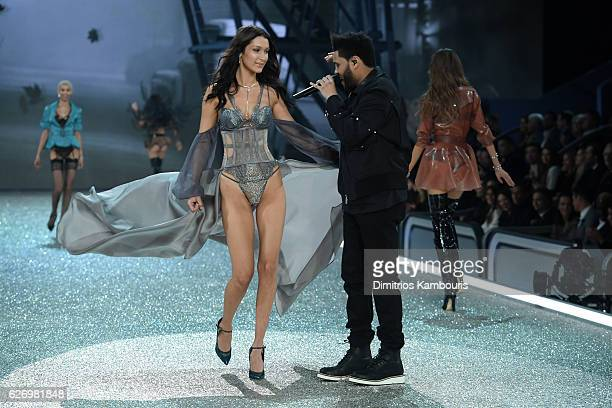 Bella Hadid walks the runway while The Weeknd performs during the 2016 Victoria's Secret Fashion Show on November 30 2016 in Paris France