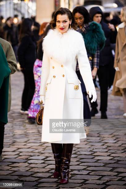 Bella Hadid, wearing a white coat with fur collar, is seen outside Lanvin, during Paris Fashion Week - Womenswear Fall/Winter 2020/2021 : Day Three...