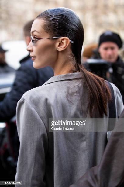 Bella Hadid, wearing a white top, white sneakers and grey suit, is seen outside Haider Ackermann on Day 6 Paris Fashion Week Autumn/Winter 2019/20 on...