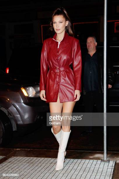 Bella Hadid wears a maroon leather outfit paired with knee high boots as she arrives at her mom Yolanda Hadid's apartment on her birthday on January...