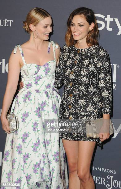 Bella Heathcote and Phoebe Tonkin arrive at the 3rd Annual InStyle Awards at The Getty Center on October 23 2017 in Los Angeles California