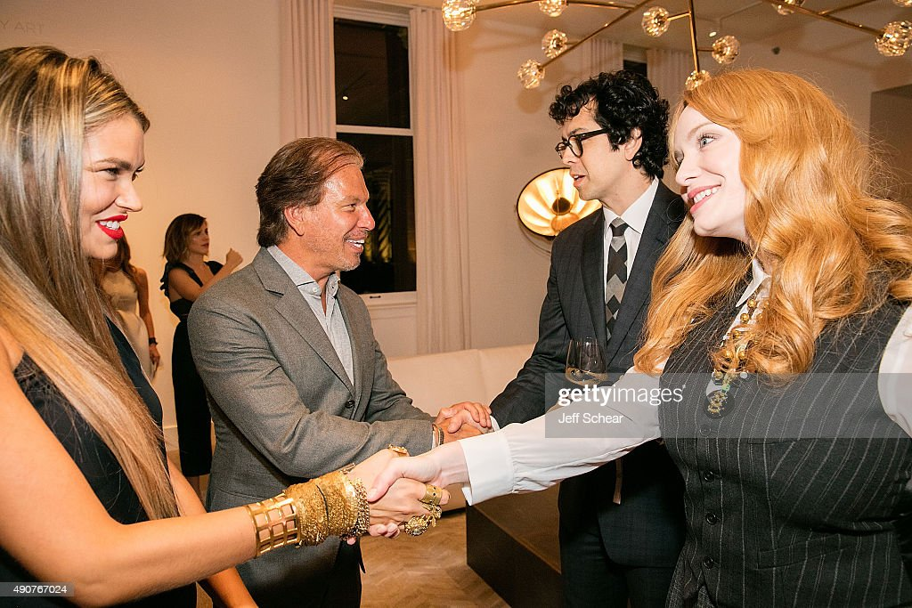 Bella Hunter, RH Chairman and Chief Executive Officer Gary Friedman, Geoffrey Arend, and Christina Hendricks attend Restoration Hardware Celebrates The Opening Of RH Chicago - The Gallery At The Three Arts Club at Restoration Hardware on September 30, 2015 in Chicago, Illinois.
