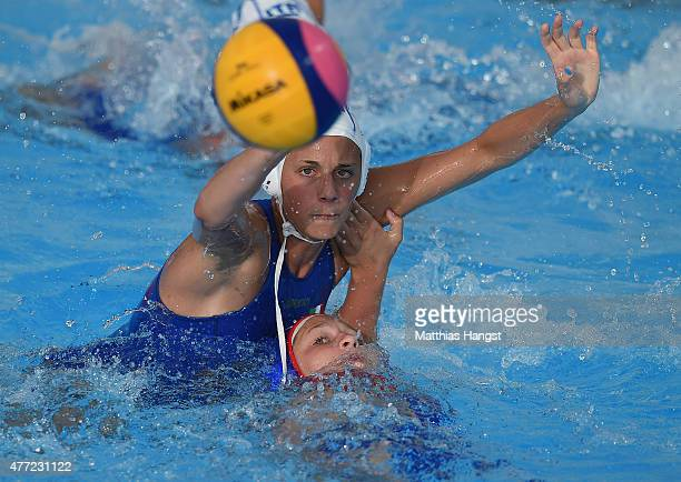Bella Khamzaeva of Russia battles for the ball with Elena Altamura of Italy during the Womens' Water Polo Group B match between Italy and Russia on...