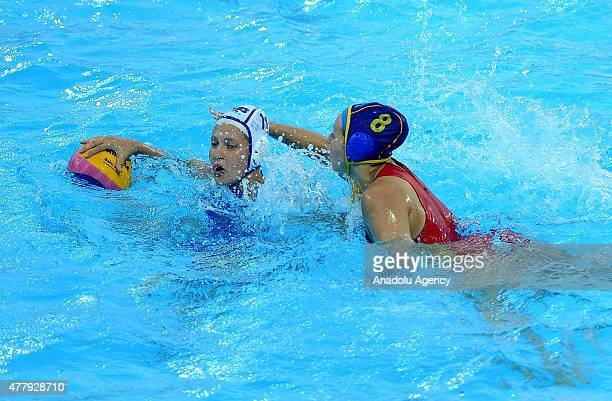 Bella Khamzaeva of Russia vies for the ball with Carmen Baringo Romeron of Spain the Women's Waterpolo Final between Russia and Spain during day...