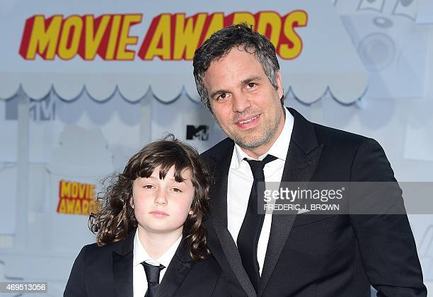 Bella Noche Ruffalo and actor Mark Ruffalo pose on arrival for the 2015 MTV Movie Awards on April 12 2015 in Los Angeles California AFP PHOTO /...