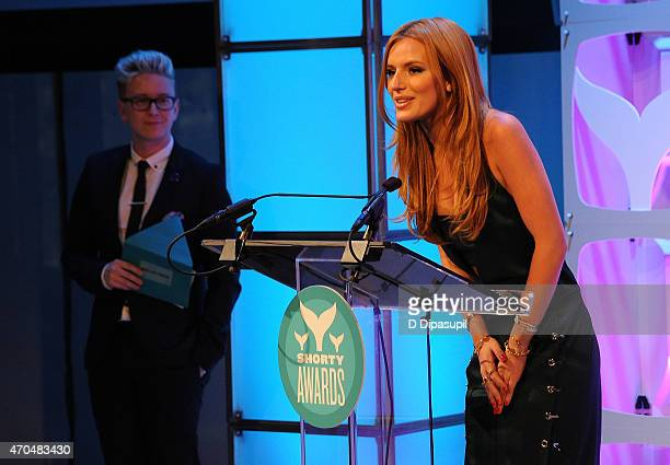Bella Thorne accepts a Shorty Award from Tyler Oakley during the 7th Annual Shorty Awards on April 20 2015 in New York City