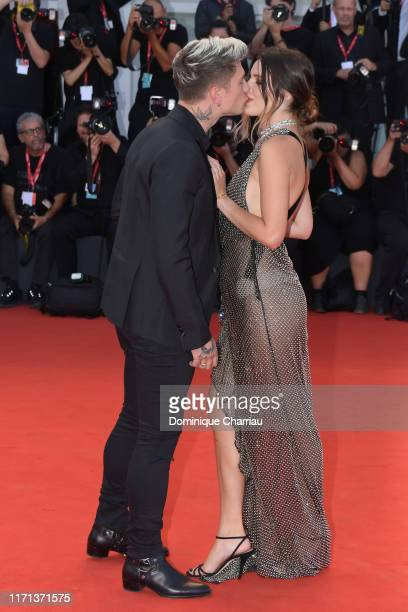 """Bella Thorne and Benjamin Mascolo walk the red carpet ahead of the """"Joker"""" screening during the 76th Venice Film Festival at Sala Grande on August..."""