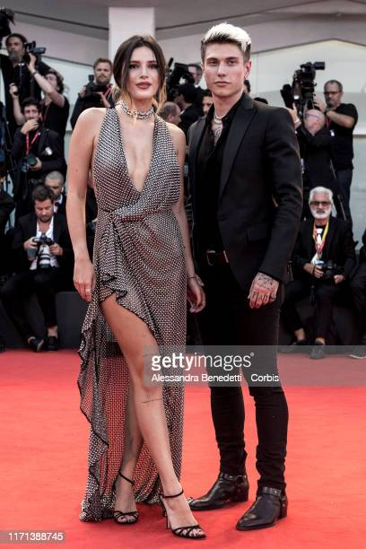 Bella Thorne and Benjamin Mascolo walk the red carpet ahead of the Joker screening during the 76th Venice Film Festival at Sala Grande on August 31...