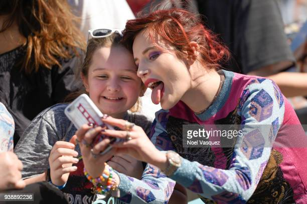 Bella Thorne takes selfies with fans at Extra at Universal Studios Hollywood on March 27 2018 in Universal City California
