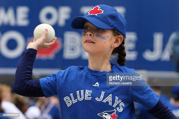 Bella Wood 10 has a laugh as she plays catch with her brothers outside of the Rogers Centre prior to the start of the game The Toronto Blue Jays took...