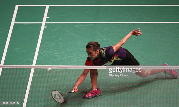 Bellaetrix Manuputty of Indonesia stretches to retrieve the shuttle during the match against Li Xuerui of China during day four of the Woman's...