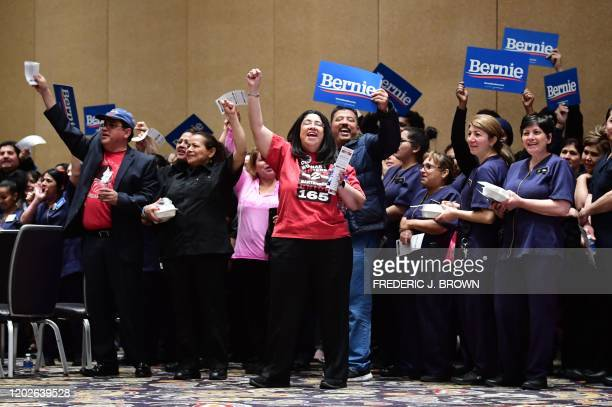 Bellagio hotel workers hold Bernie placards before casting their votes during the Nevada caucuses to nominate a Democratic presidential candidate at...