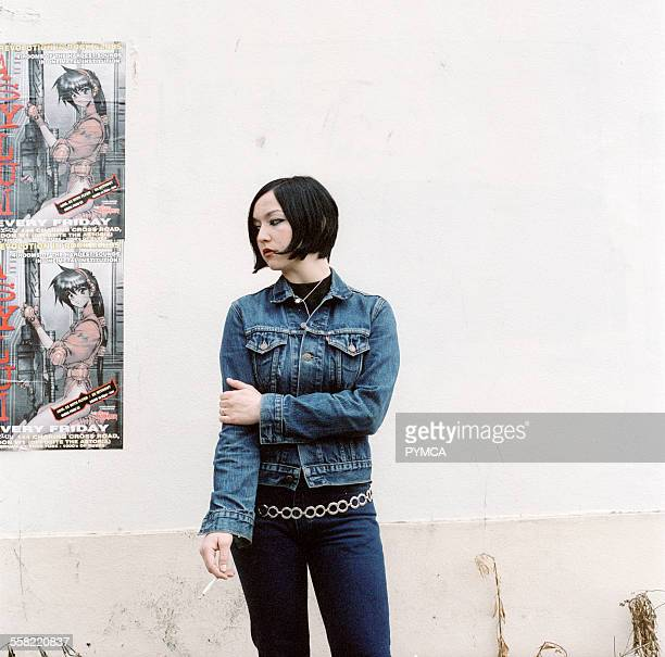 Bellam Girl in a denim jacket smoking a cigarette 2000s