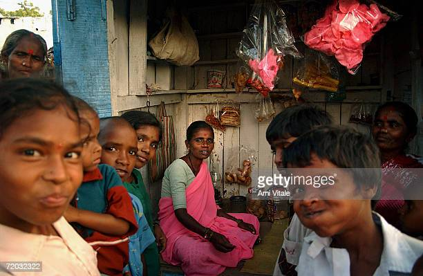 Bellama sits inside her food stand that she was able to set up after the government gave her a loan in this photo taken on August 23 2005 in...