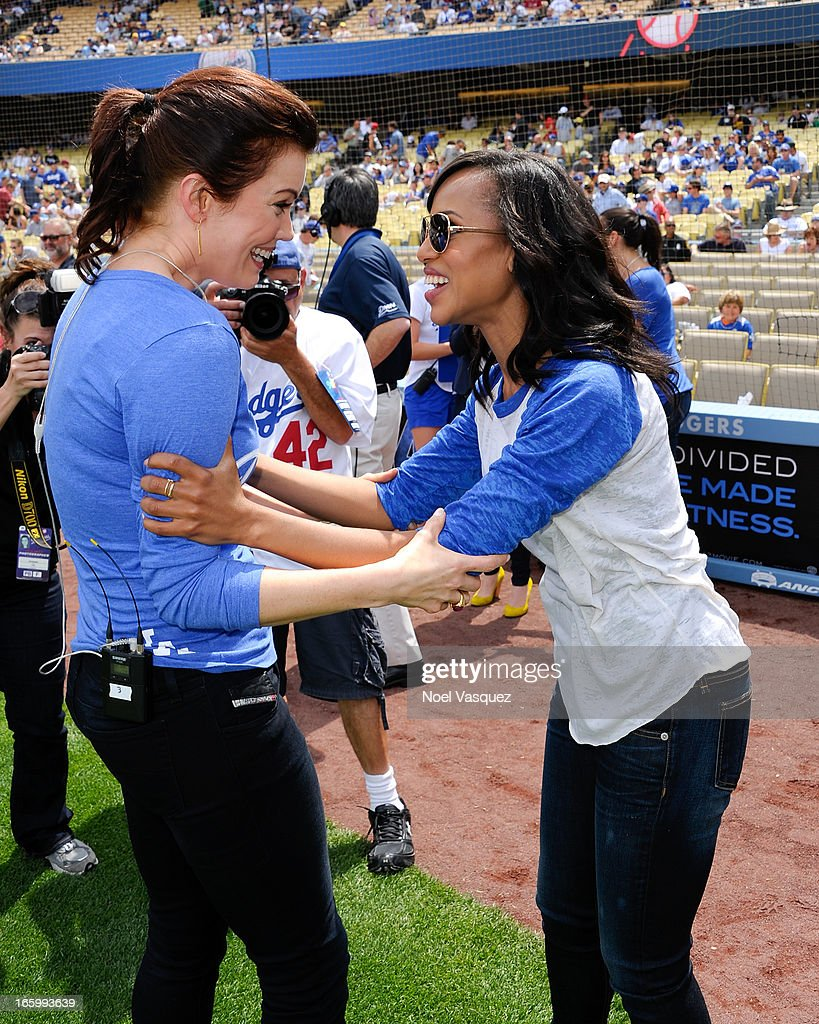 Bellamy Young (L) and Kerry Washington, from the television show 'Scandal', attend a baseball game between the Pittsburgh Pirates and the Los Angeles Dodgers at Dodger Stadium on April 7, 2013 in Los Angeles, California.