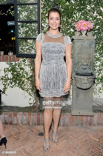Bellamy Young attends a dinner celebrating Kerry Washington hosted by ELLE EditorInChief Robbie Myers and Movado Chairman CEO Efraim Grinberg at AOC...