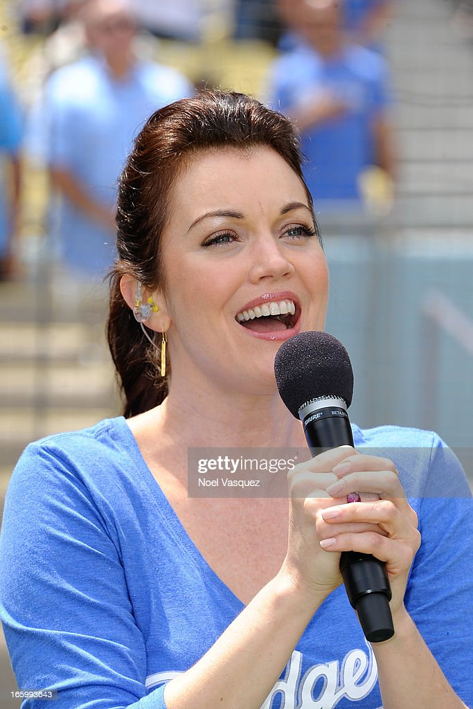 Bellamy Young, from the television show 'Scandal', sings the national anthem at a baseball game between the Pittsburgh Pirates and the Los Angeles Dodgers at Dodger Stadium on April 7, 2013 in Los Angeles, California.