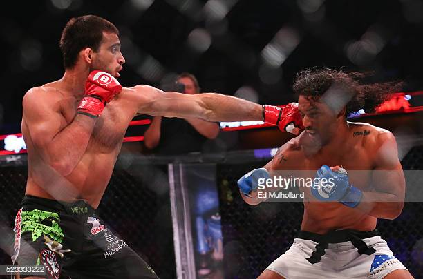 Bellator welterweight champion Andrey Koreshkov lands a left hand to the head of challenger Benson Henderson during their main event bout of Bellator...