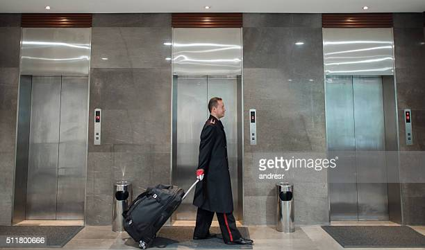 Bellboy carrying bags at the hotel